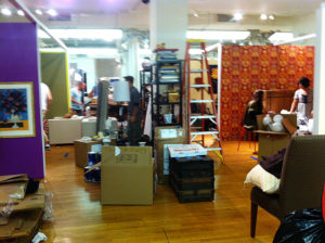 Packing materials, boxes, furniture, and decorative accessories continued through all the aisles.
